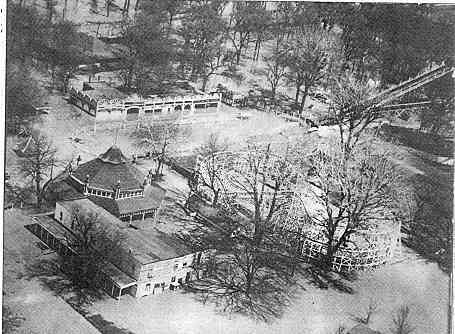 Black and white aerial of building at lake contrary